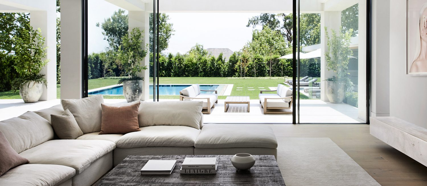 The living room of Toorak Garden opens to the backyard and pool.