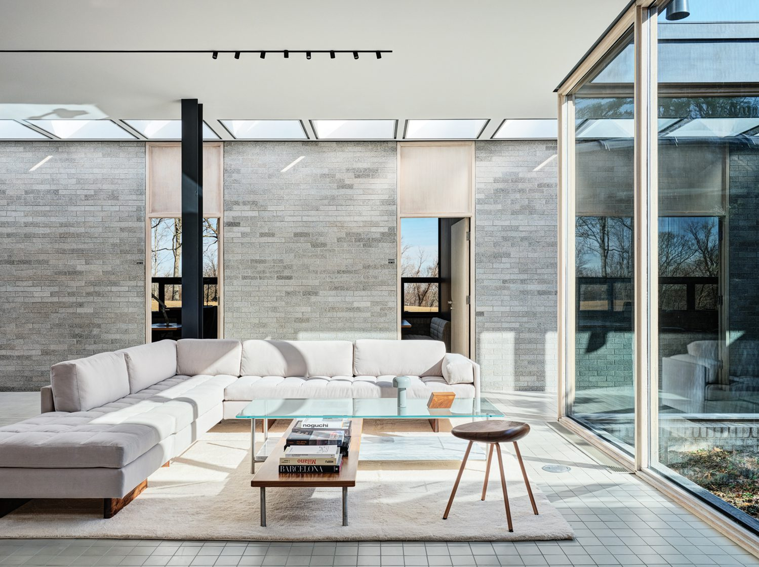 The lounge's Asymmetric sectional, Pebble stool, and Layer table. Photography by Michael Biondo.