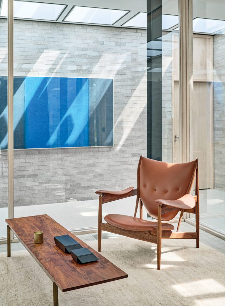 Finn Juhl's Chieftain chair from the 1950's and a BassamFellows Plank table. Photography by Michael Biondo.