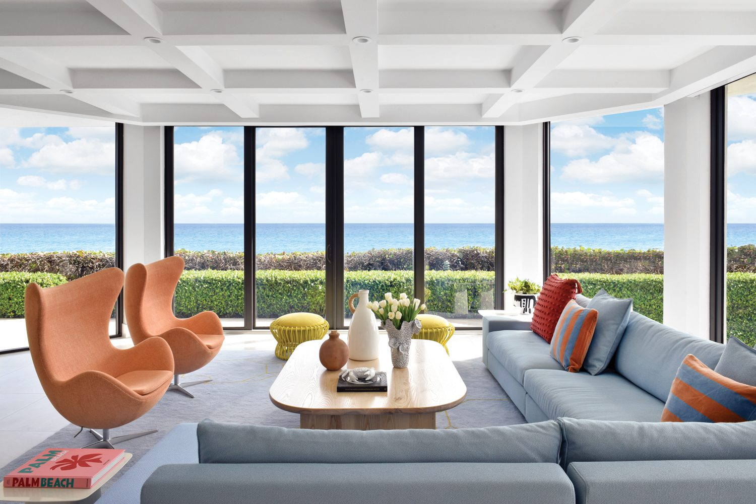 In the living area, which enjoys front-row ocean views, Arne Jacobsen Egg chairs join a Didier Gomez Exclusif sectional upholstered in Viñas's Sister Solid polyester-acrylic.