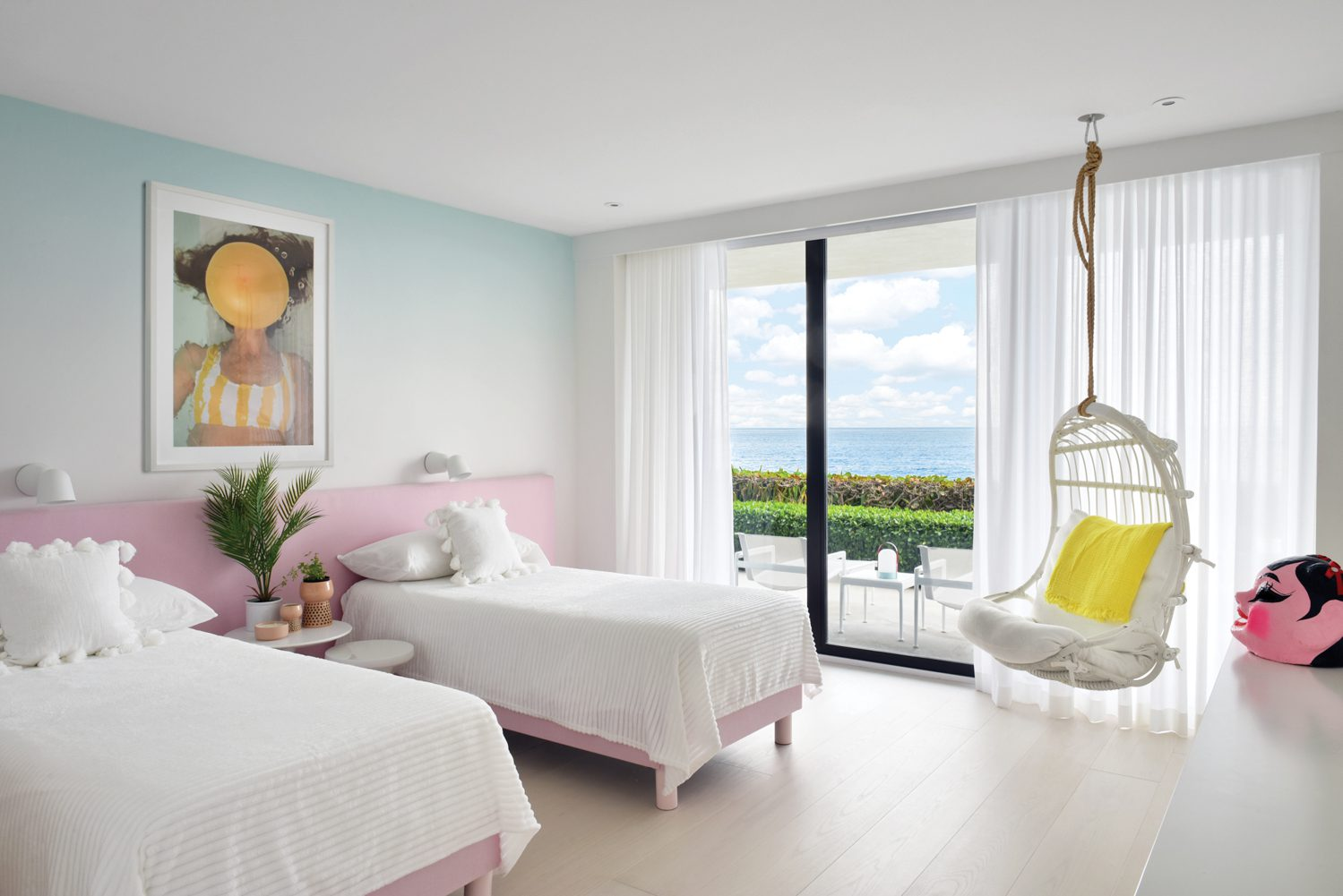 Carla Sutera Sardo's AQVA Orange accents custom ombré wallpaper in the daughter's room, where a superlong cotton-linen-covered headboard enables the twin beds to be pushed together or pulled apart as desired.