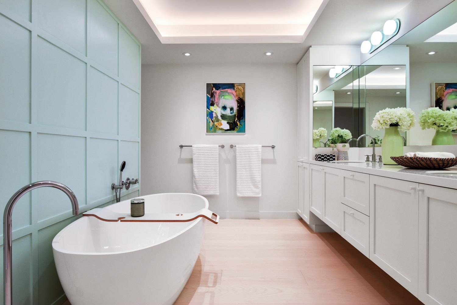 The primary bathroom's gridlike millwork echoes the coffered ceiling of the living area; Menghan Qi's Banana Traveler hangs on the far wall.