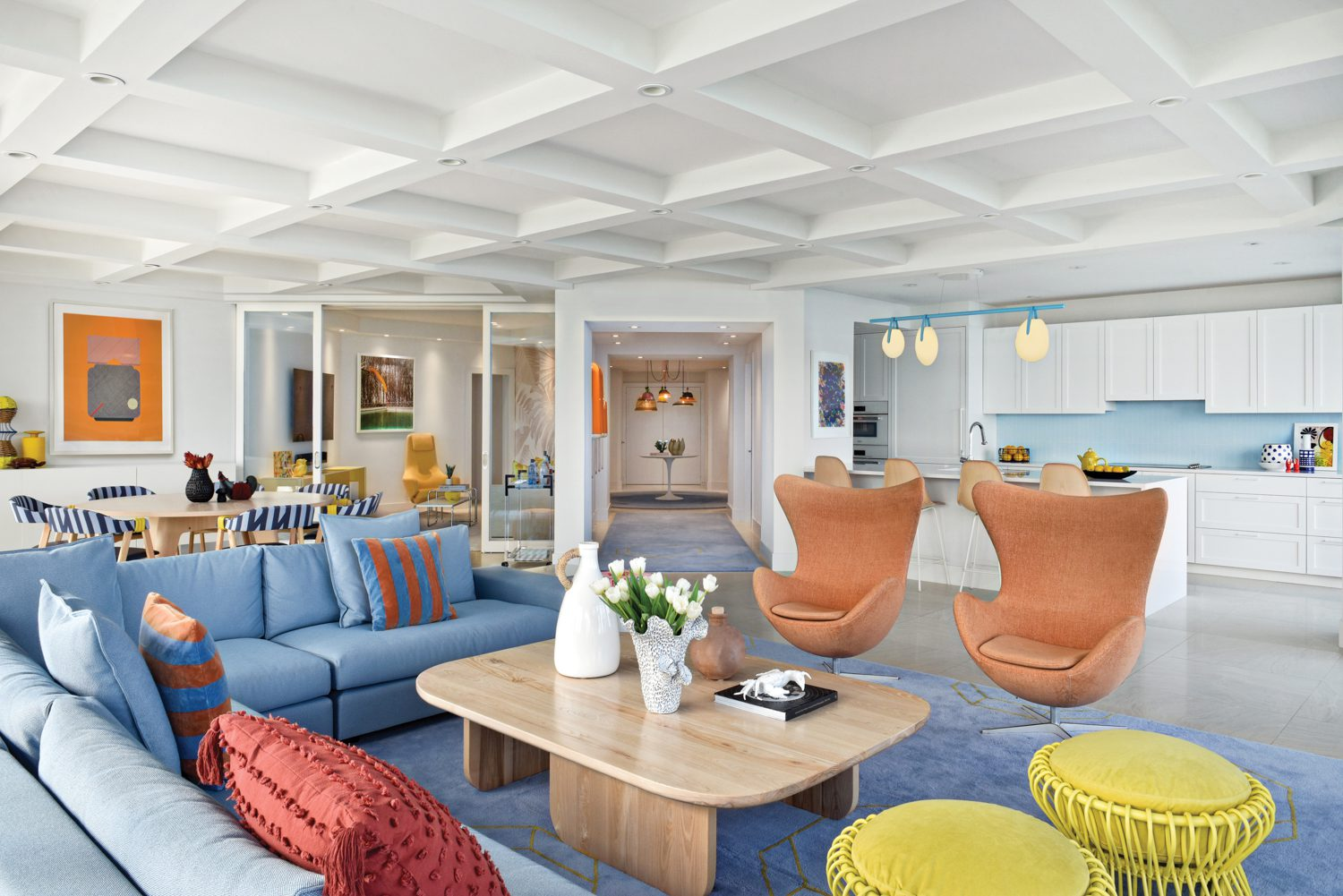 Viñas designed TriBecCa, the wool rug that anchors the living area seating group, which is serviced by a custom bleached-ash coffee table and Ultrasuede-covered Taiko poufs by Tomoko Mizu.