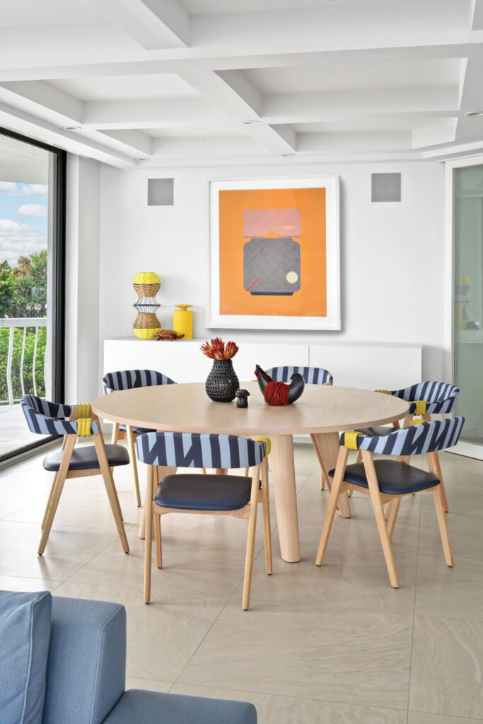 Viñas's Sir Stripe-a-lot Sunbrella acrylic-polyester accents Mathilda dining chairs by Patricia Urquiola; above the credenza hangs Fox's Grandma's Lamp.