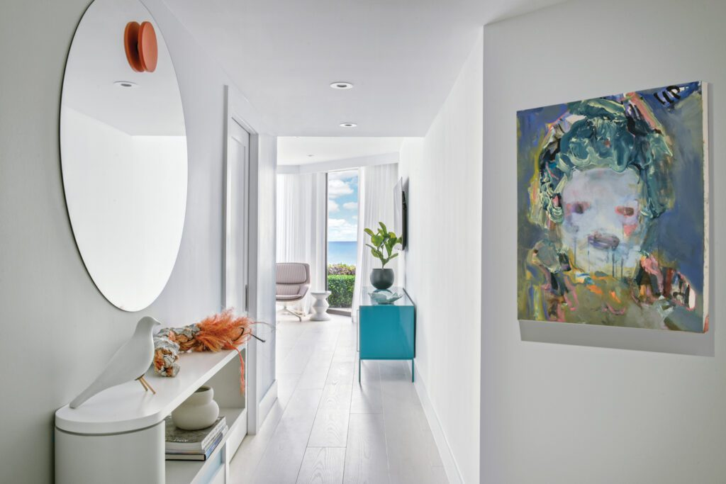 A custom mirror and Menghan Qi's Audrey's Landscape animate the hallway leading to the primary bedroom.