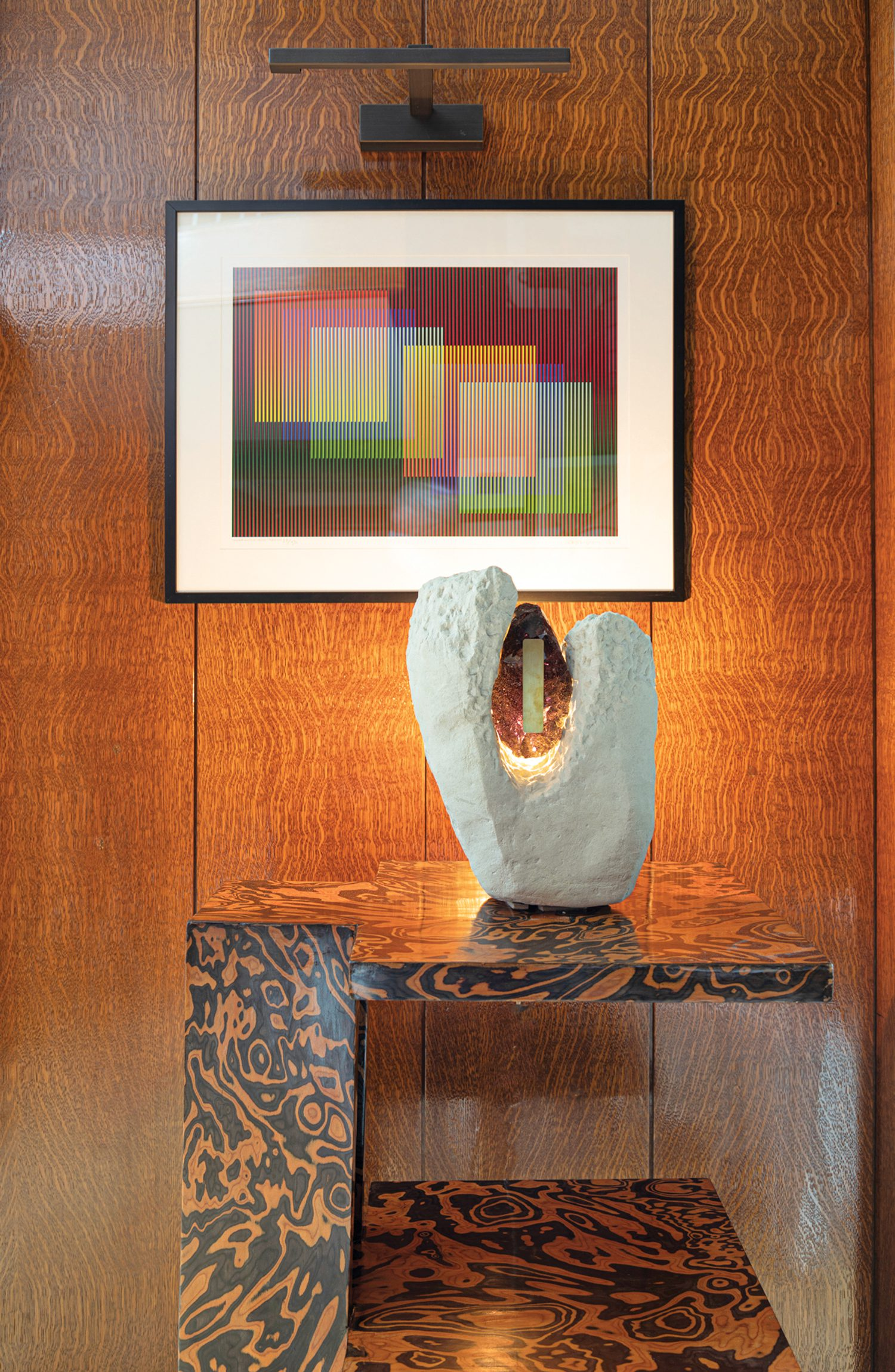 A Carlos Cruz-Diez work hangs above the sitting room's vintage painted-wood André Sornay console, with an Iris Totem light sculpture by Audrey Guimard and Marie Jeunet.
