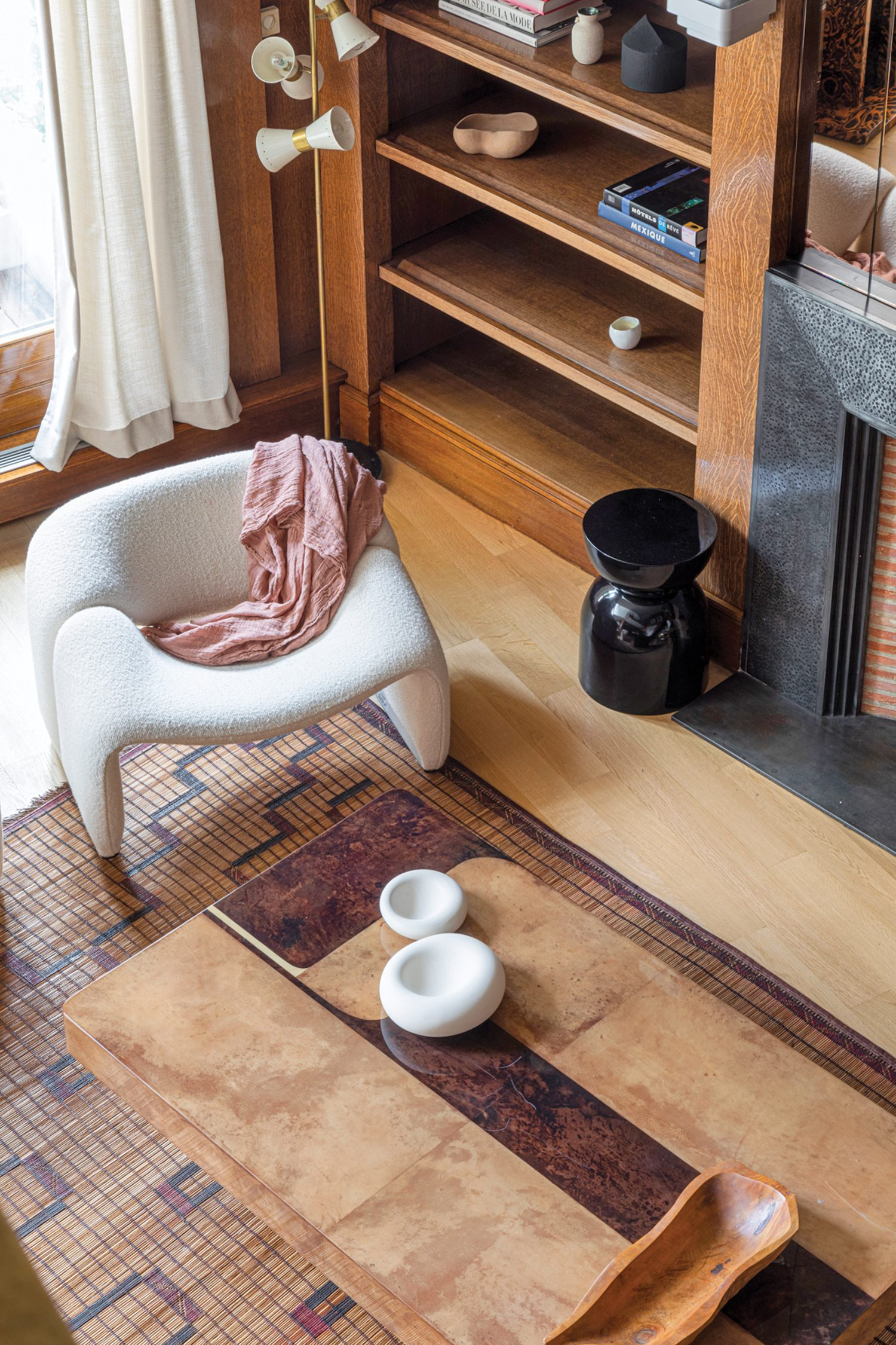 A vintage Aldo Tura coffee table in lacquered parchment hosts ceramics by Brielle Rovito in the sitting room.