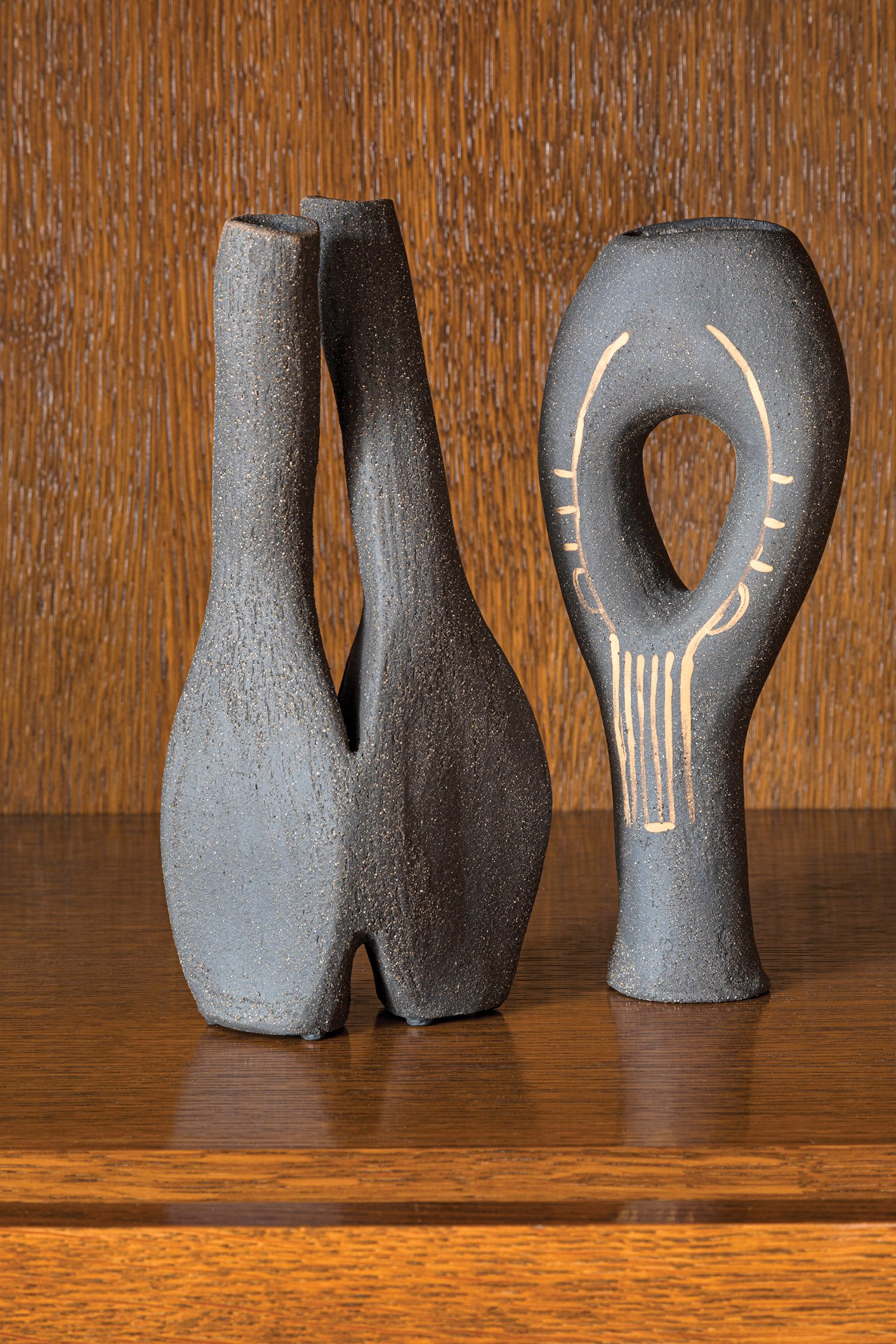 Ceramics by Abid Javed have pride of place on the sitting room shelving.