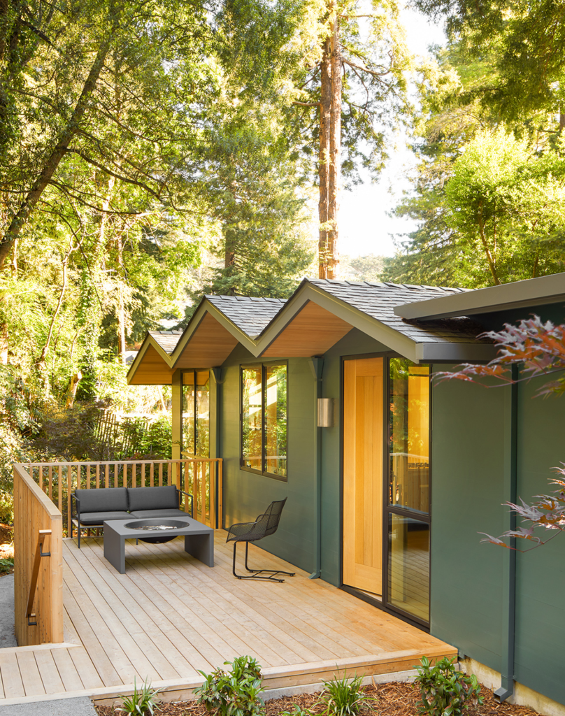 The cottage was reclad with cedar siding, the same wood used for the front porch's railing and decking.