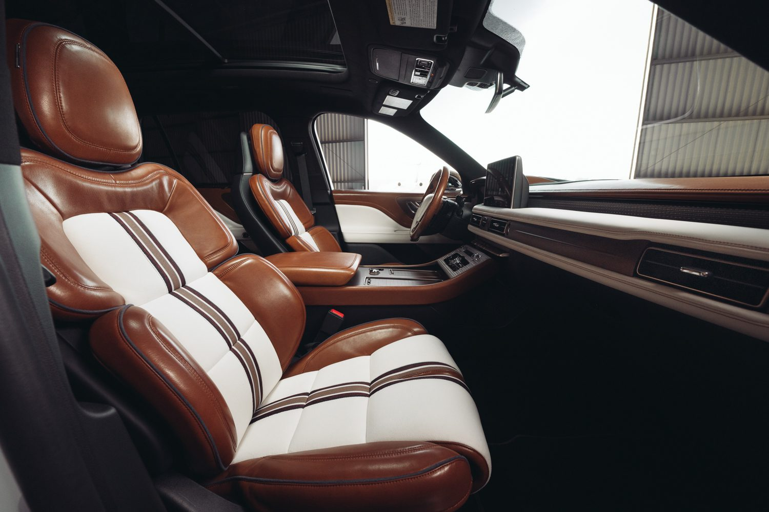 Leather seats feature suede inserts with a branded Lincoln X Shinola stripe.