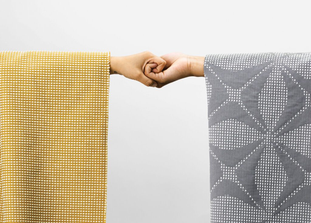 Kith and Kin textiles in polyester with acrylic backing and nanotechnology stain resistance by Designtex.
