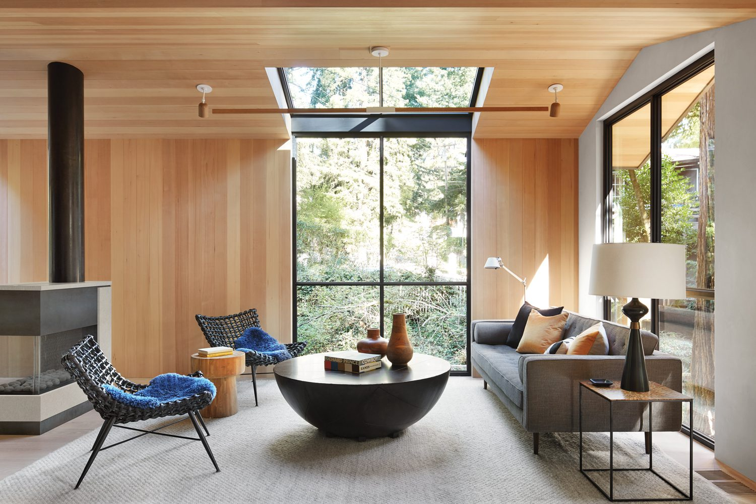 Walls and ceiling are paneled with hemlock, while flooring is European white oak.