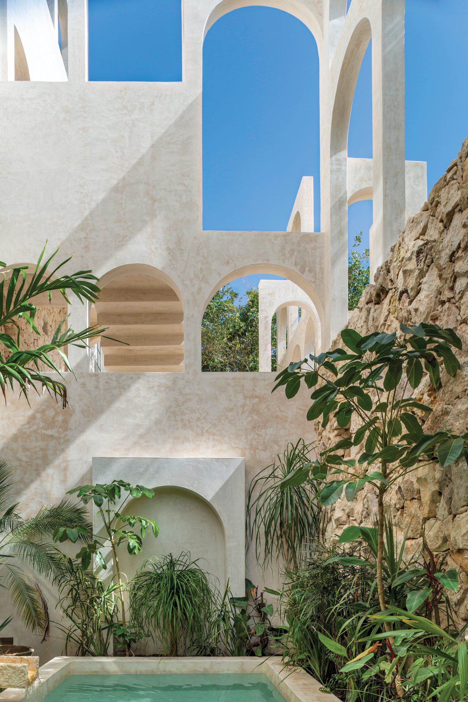 Nodding to classical architecture, a composition of arches distinguishes the four-story condominium building's facade.