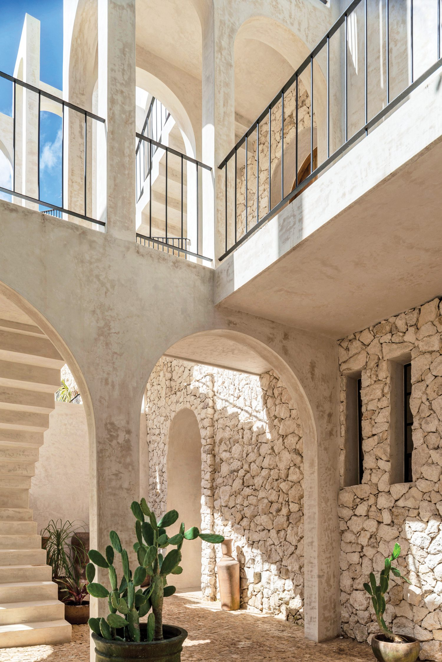 Visible on walls in the cobbled entry court is the fossilized local stone that gives the development its name.