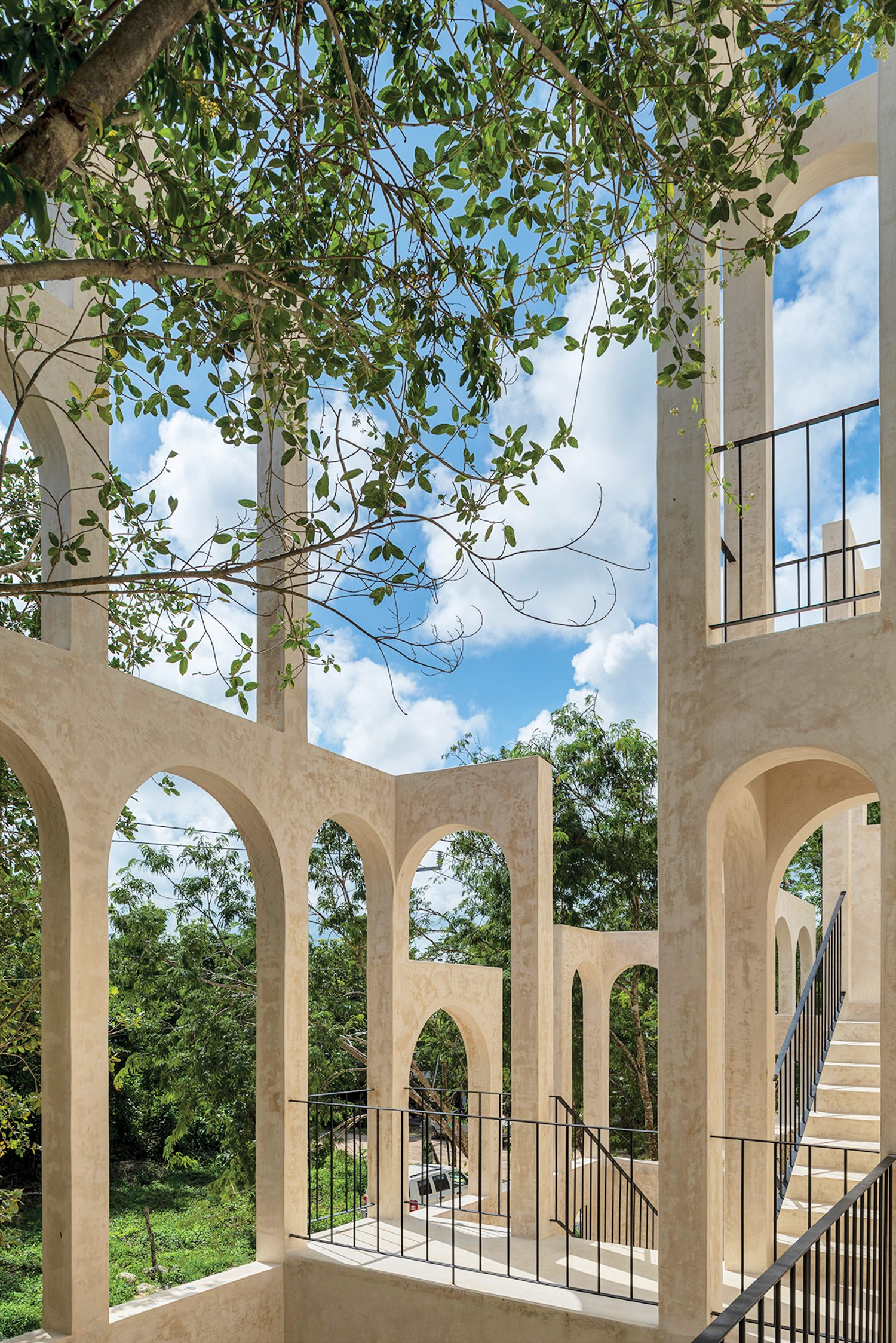 A sculptural collision of arches frames dramatic views of the jungle.