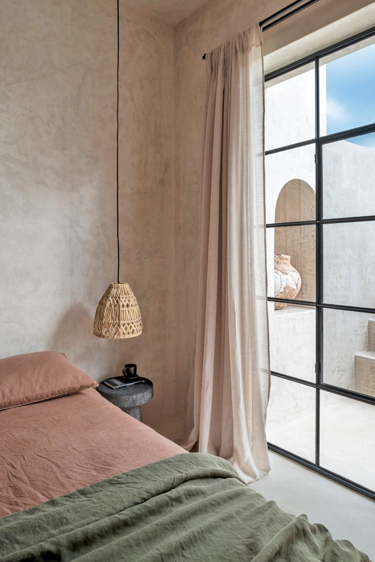 In another of the three penthouse bedrooms, the side tables are made of volcanic stone.