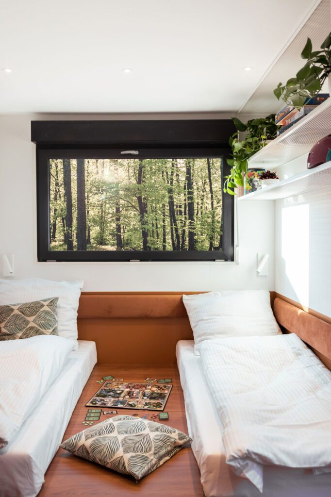 The second bedroom features two beds. Photography by Izabela Retka and Znamy się.