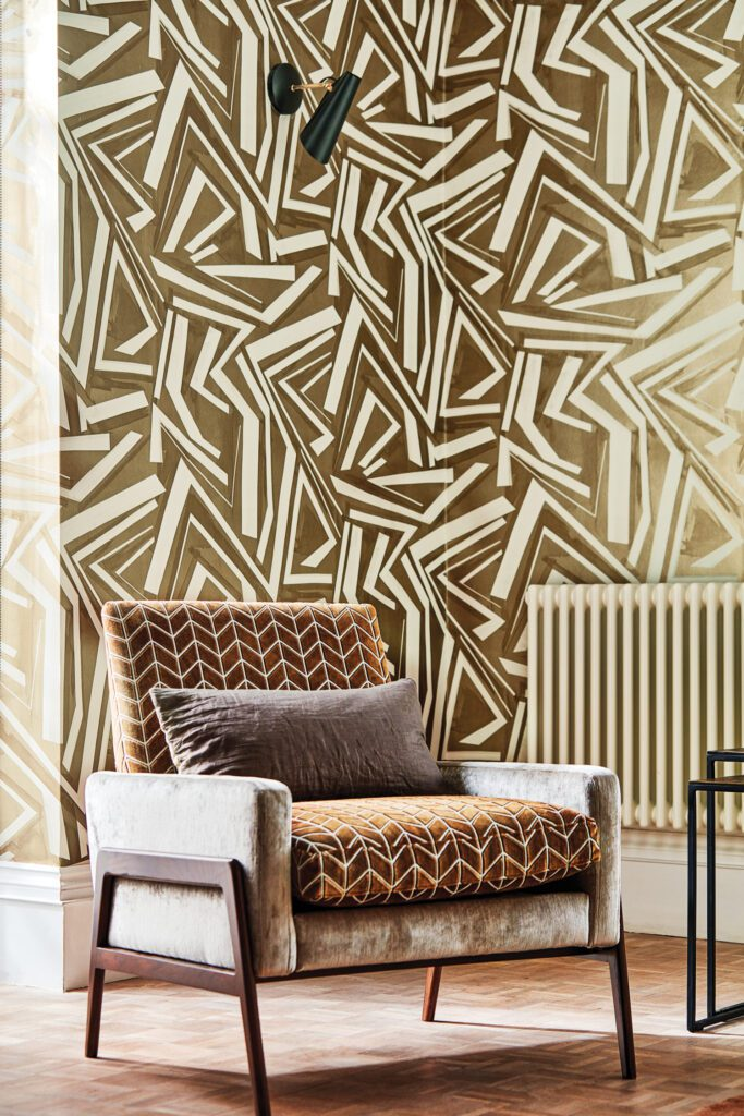 Transverse vinyl wall covering in bronze by Harlequin.