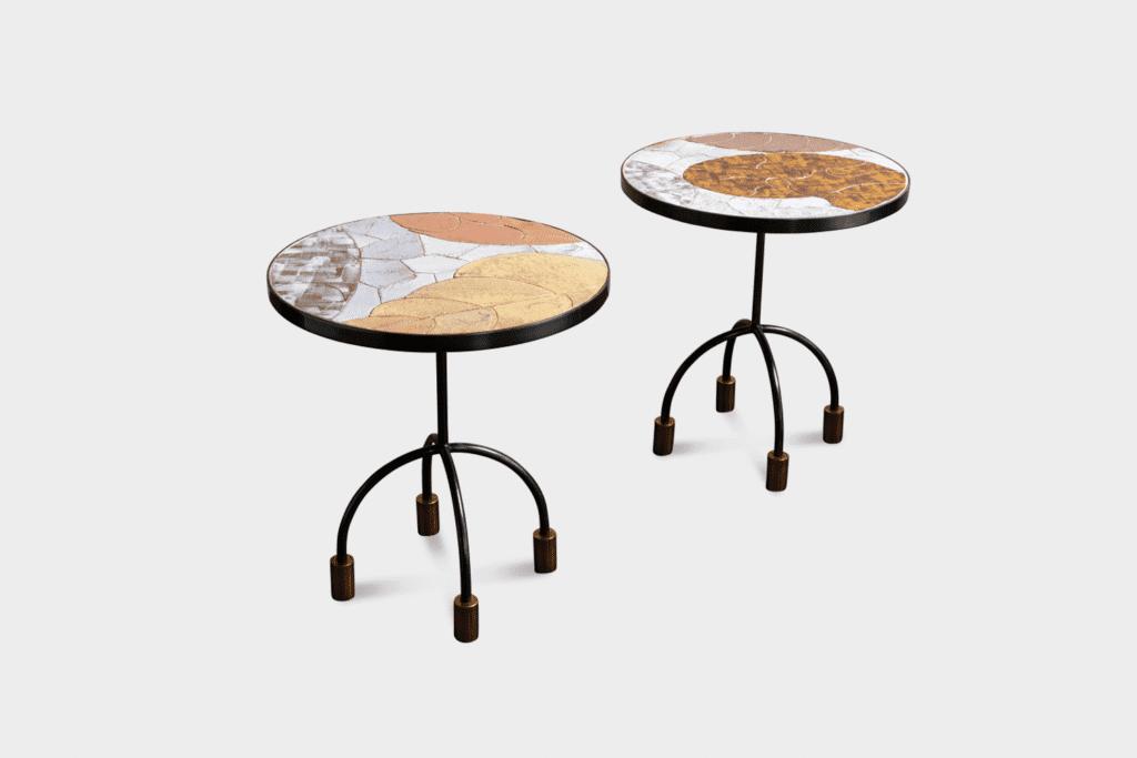 Onda ceramic-top side tables with brass legs by Kelly Wearstler.