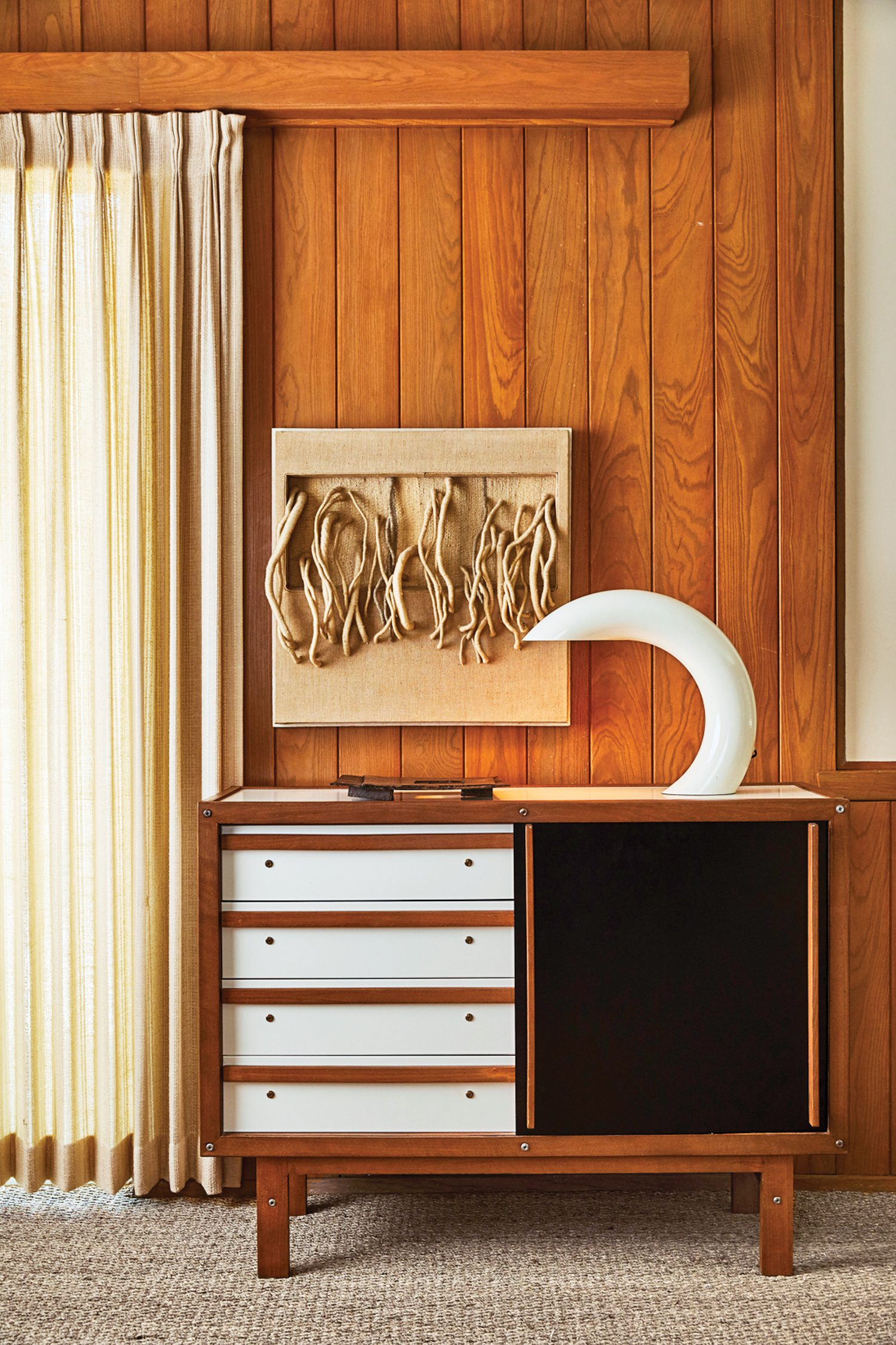 A 1960s George Frydman table lamp perches on a vintage sideboard in the family room.