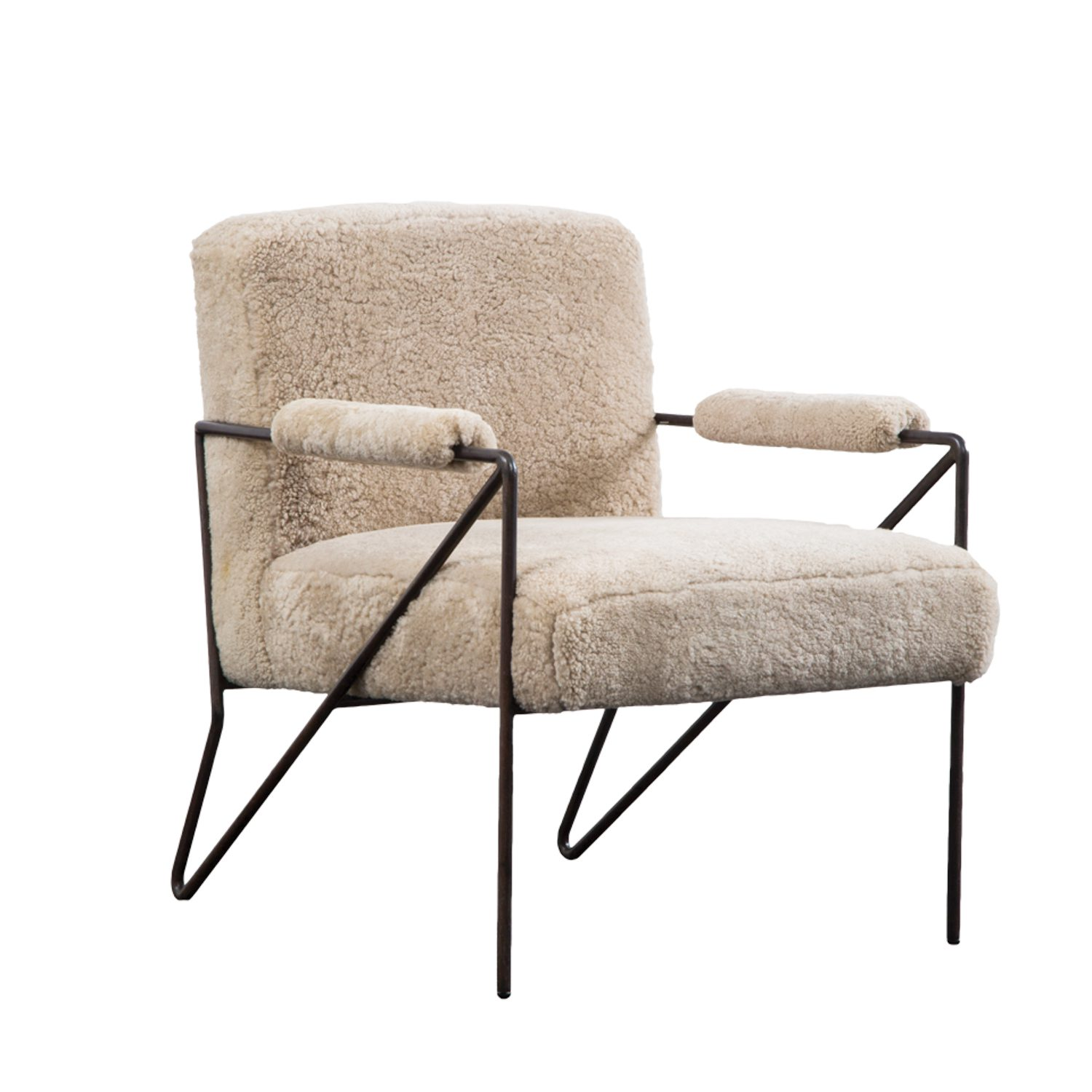 Wearstler's new Emmett indoor/outdoor lounge chair, with matte-black stainless-steel hairpin frame, is available in multiple fabrics and leathers.