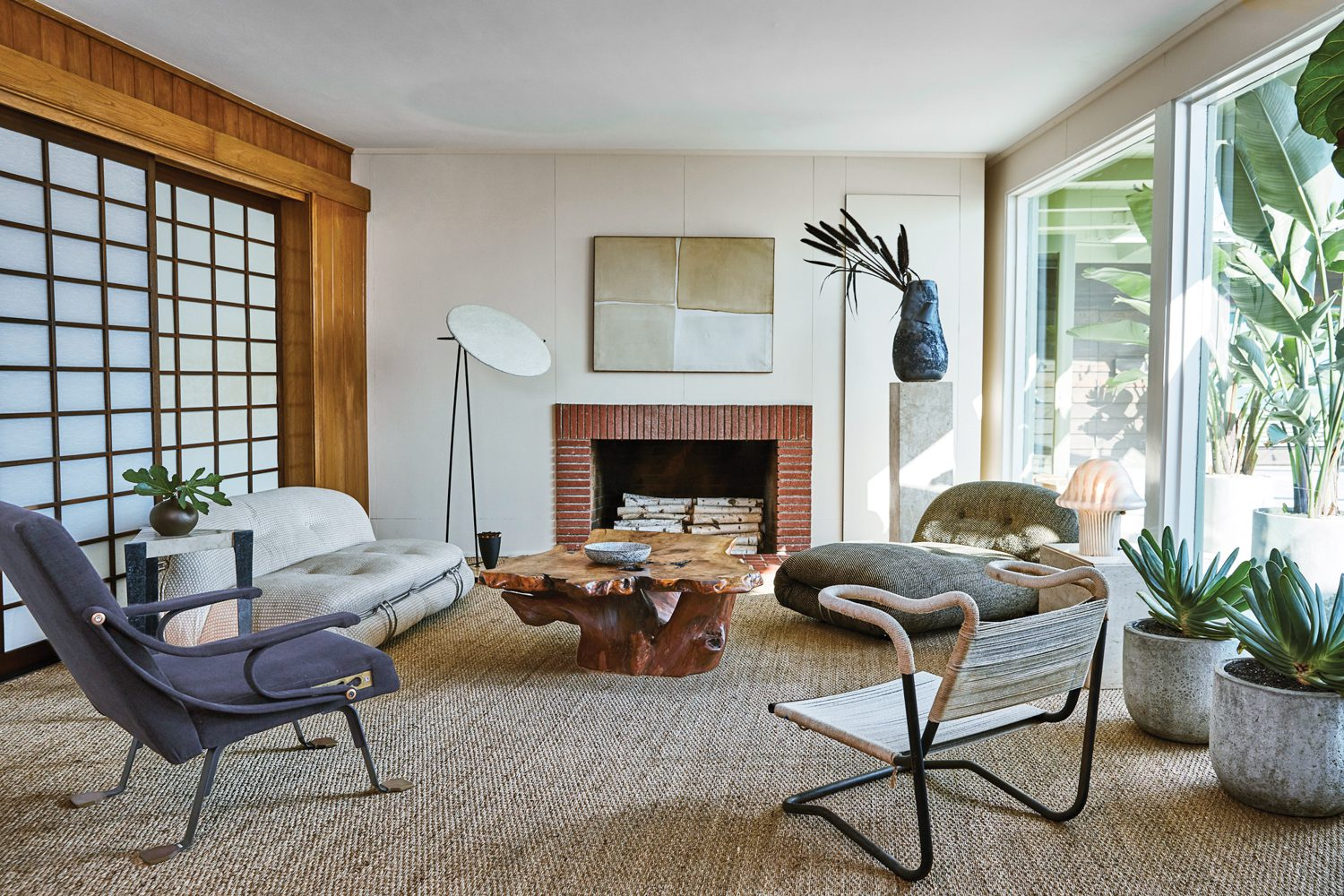 A calming, textural palette distinguishes the living room, with a vintage Soriana sofa by Tobia and Afra Scarpa and a Mitchell Bobrick Control floor lamp.