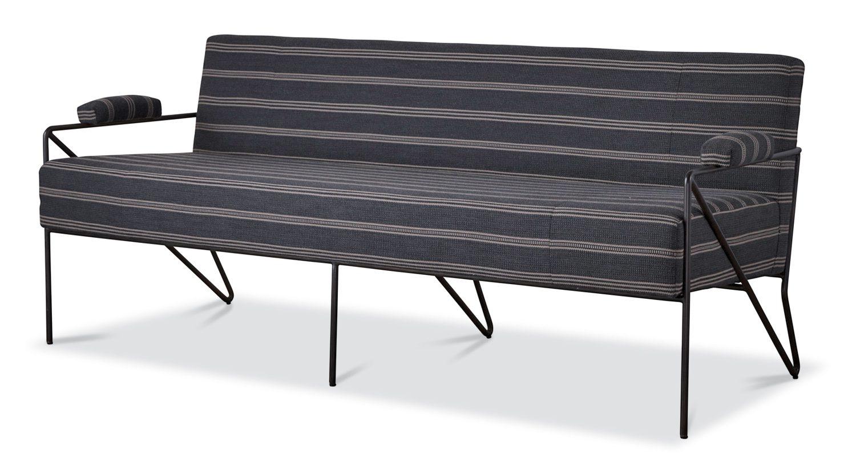 Wearstler's Emmett settee, here in leather, comfortably seats three.