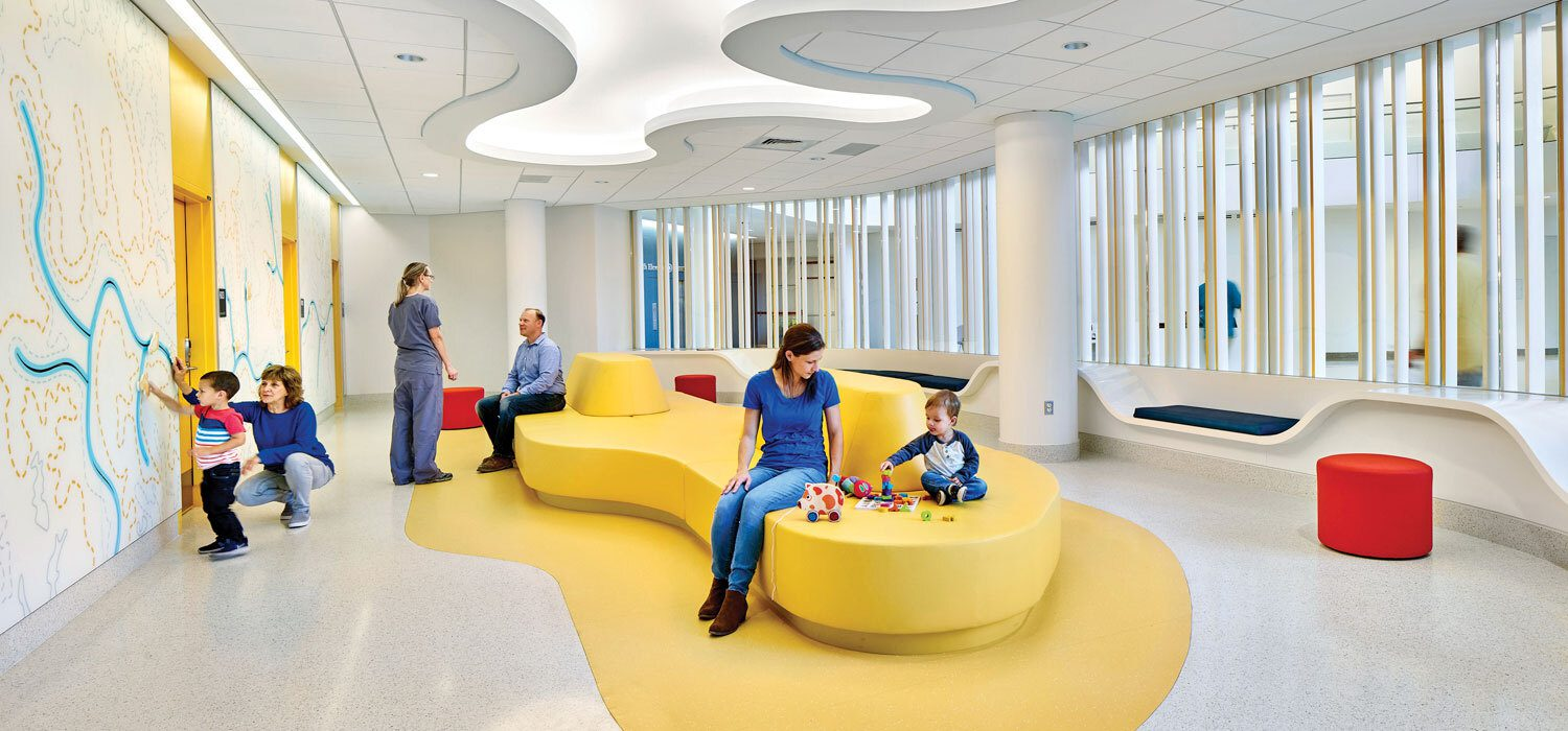 Yellow couch in the University of Virginia Hospital Designed by Perkins and Will