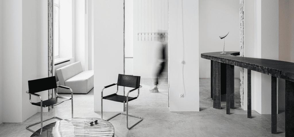 A custom graphite concrete table weighs 800 pounds. Photography: Yevhenii Avramenko and Nata Kurylenko