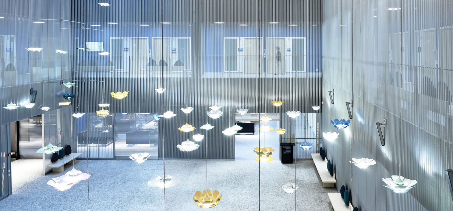 Lights suspend like jelly fish from the ceiling in Hospital Nova in Finland.
