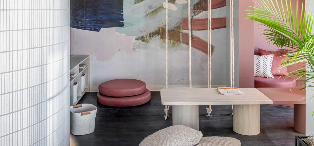A mural by Minted cheers up the kids' lounge; Benjamin Moore terra cotta paint mellows it out.