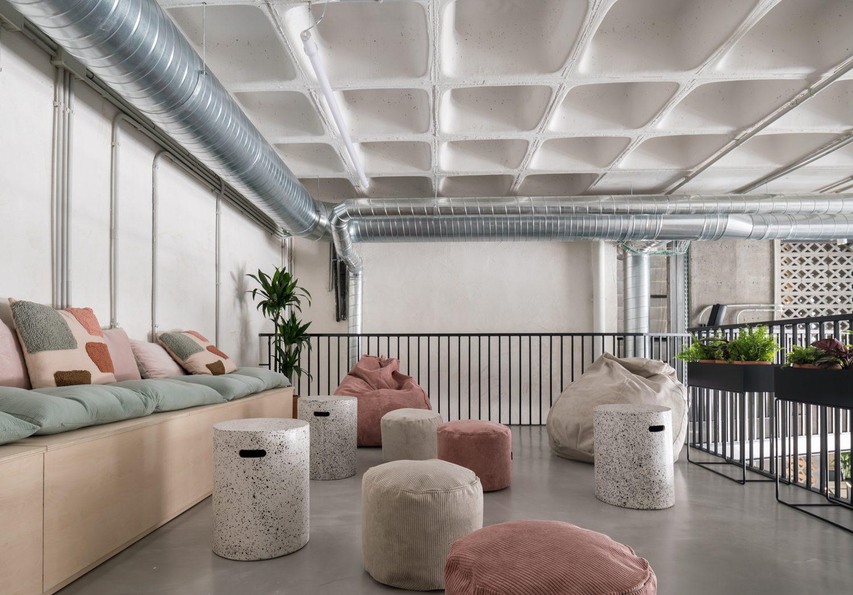 Poufs and cushioned banPoufs and cushioned banquettes fill a lounge.
