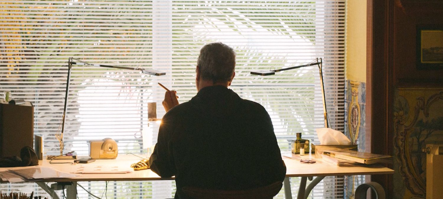 Philippe Starck at work at his desk.