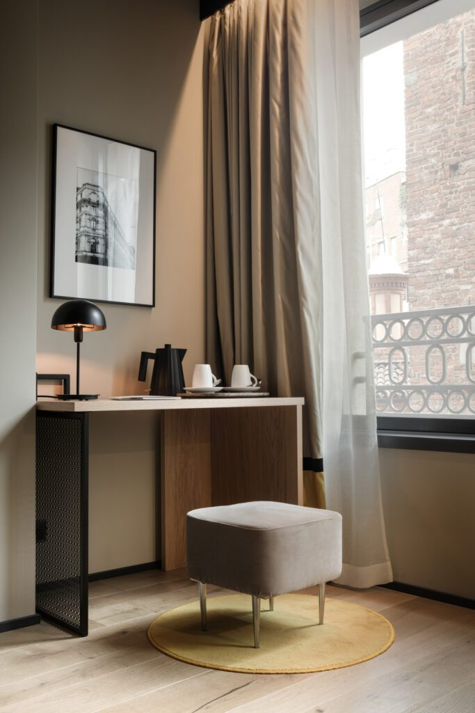 A desk by a window in a deluxe suite.