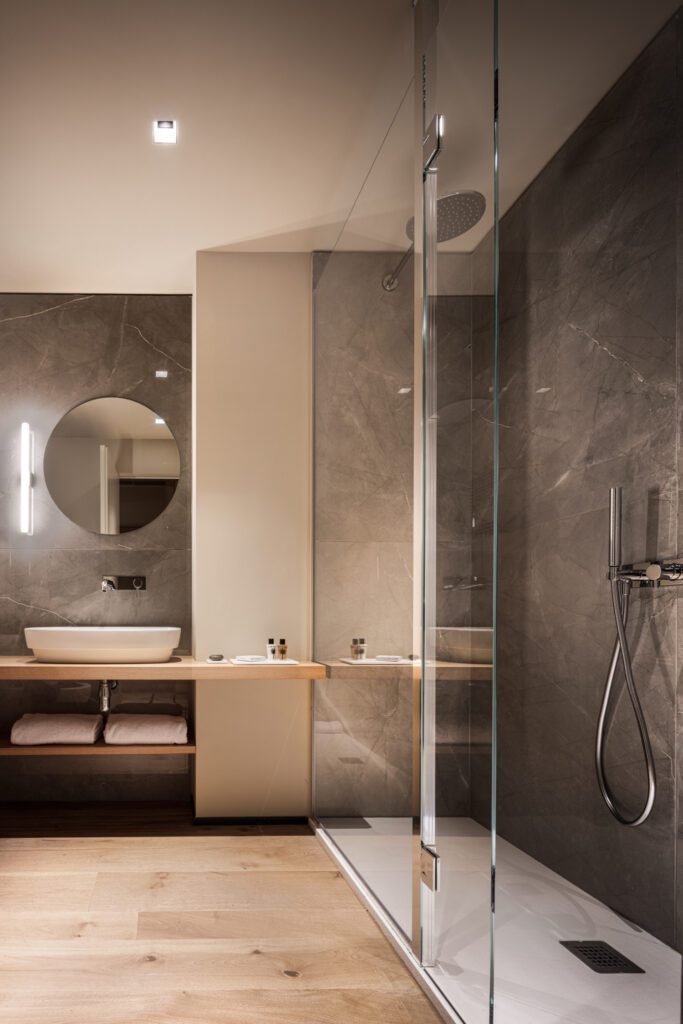 Main bath with a walk in shower and minimalist design.
