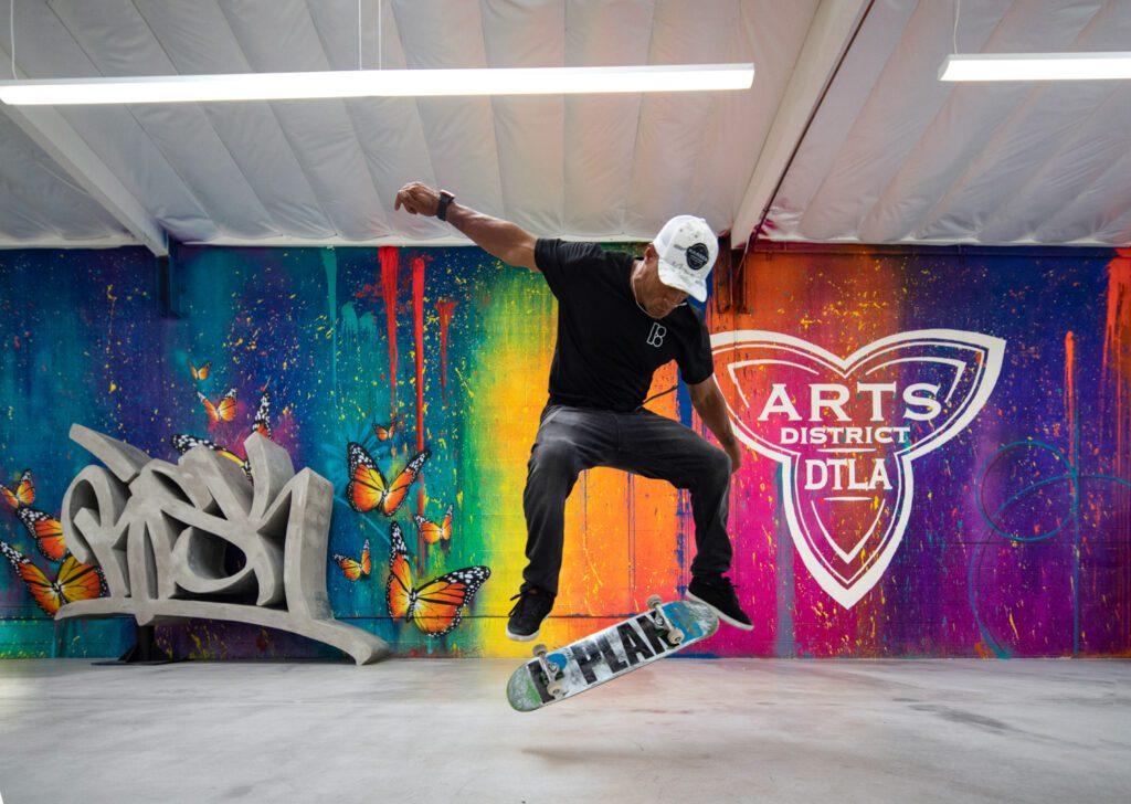 Risk's mural with logo by Damon Martin spans 100 feet.