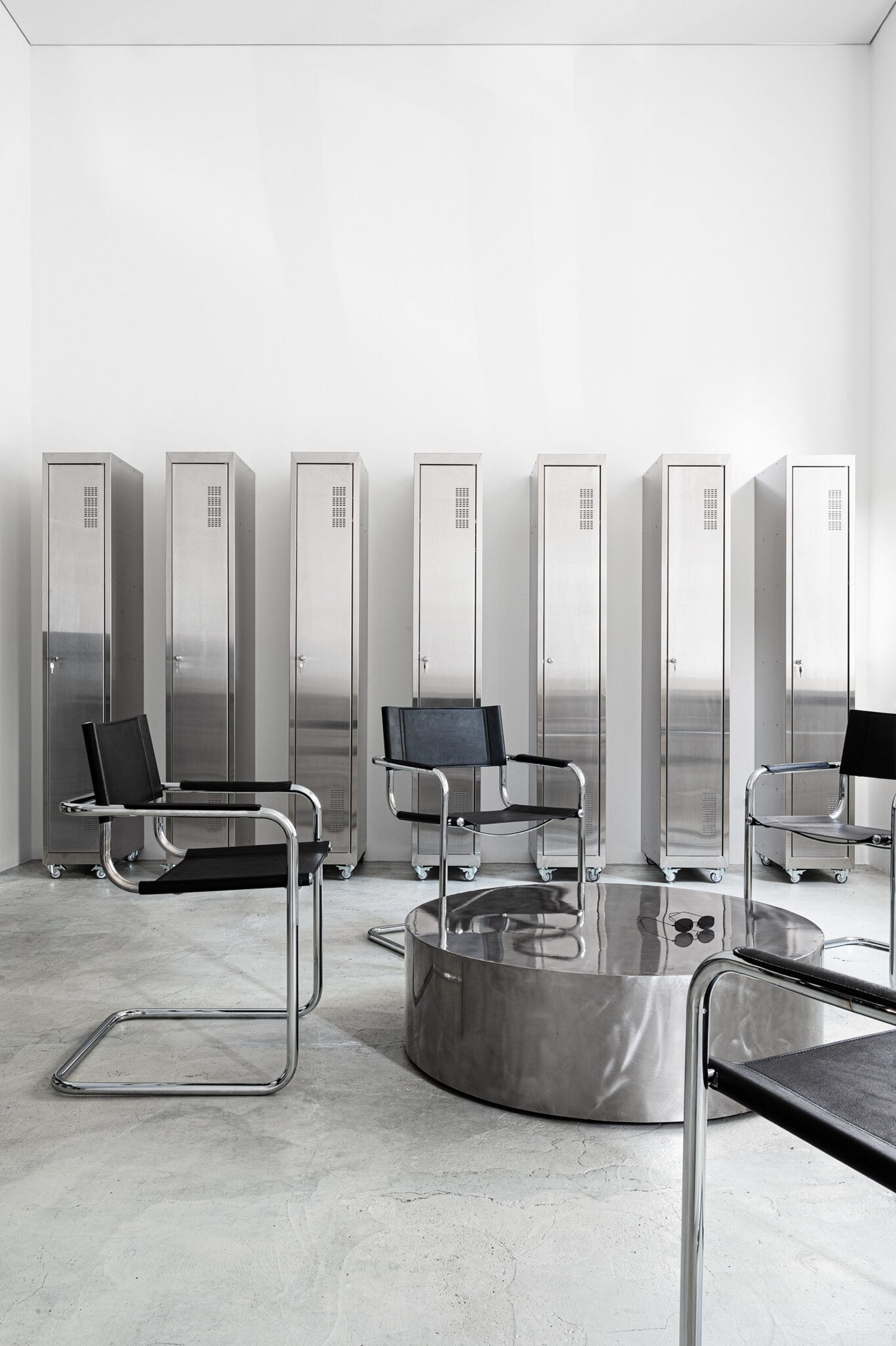 Industrial metal lockers meet vintage S34 leather and chromed steel armchairs designed by Mart Stam in 1927—the first cantilevered chair in furniture history. Photography: Yevhenii Avramenko and Nata Kurylenko
