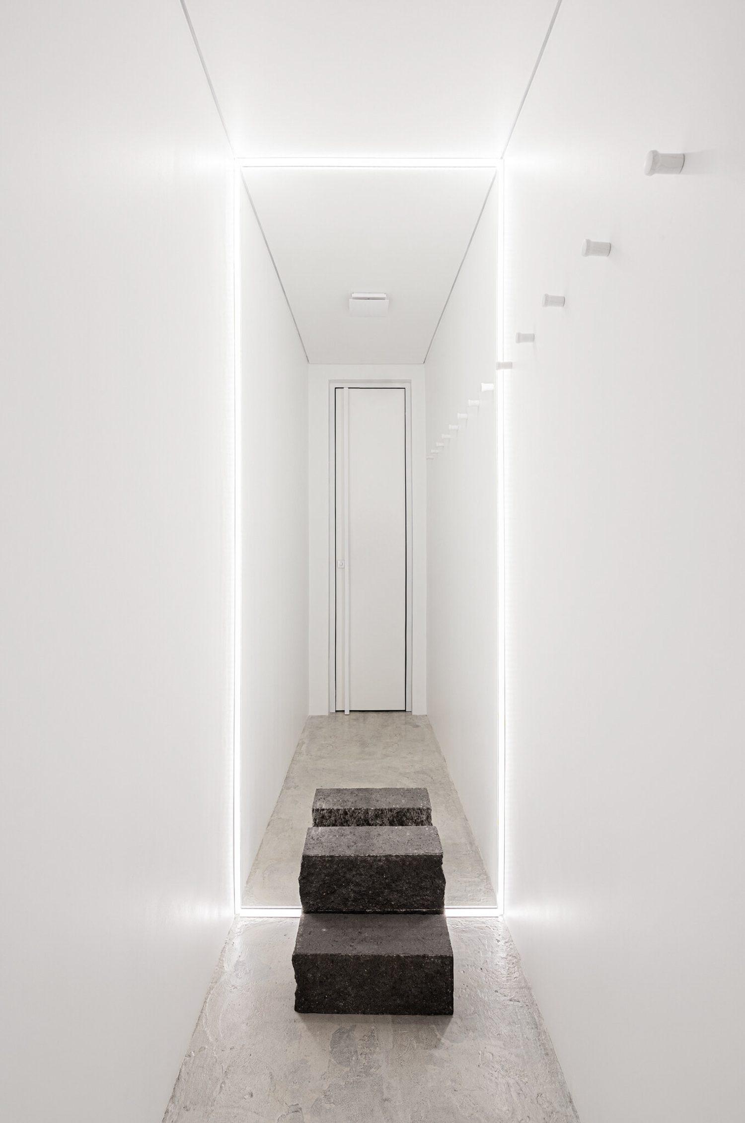 Flooring is rough-troweled concrete. Photography by Yevhenii Avramenko and Nata Kurylenko.