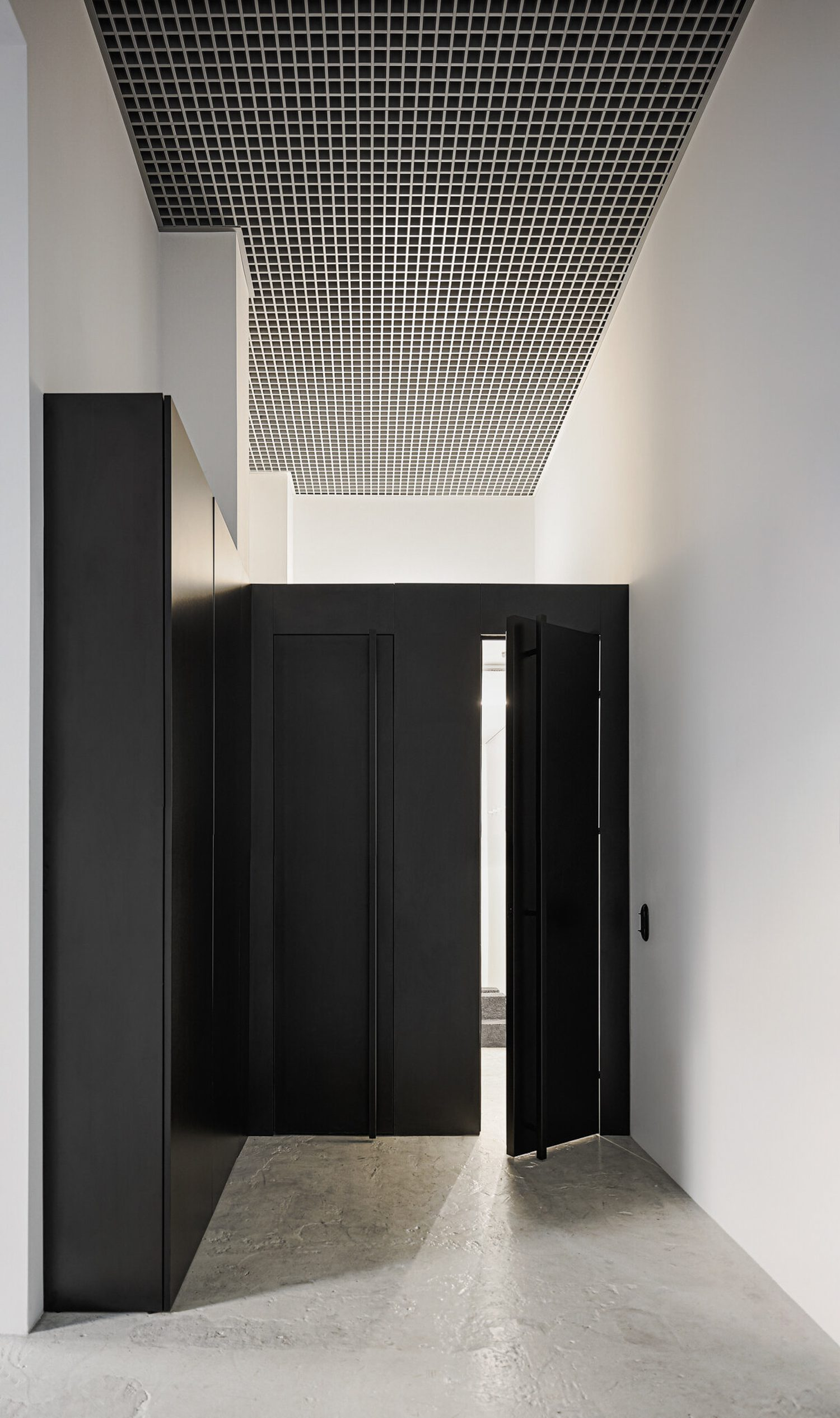 The only new element of the space is a black built-in that hides the wardrobe and bathroom.