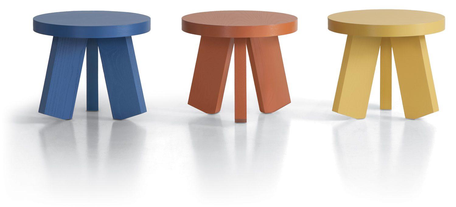 Three tri-legged tables. Blue, orange and yellow.