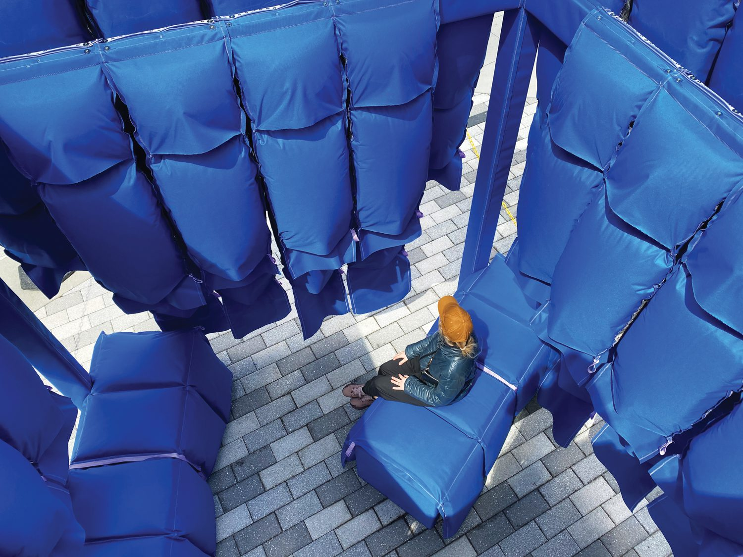Loose Fit by Elle Gerdeman, pictured here, is a large, pillowy, cobalt-blue structure composed of polished vinyl cells were packed with recycled denim from Blue Jeans Go Green