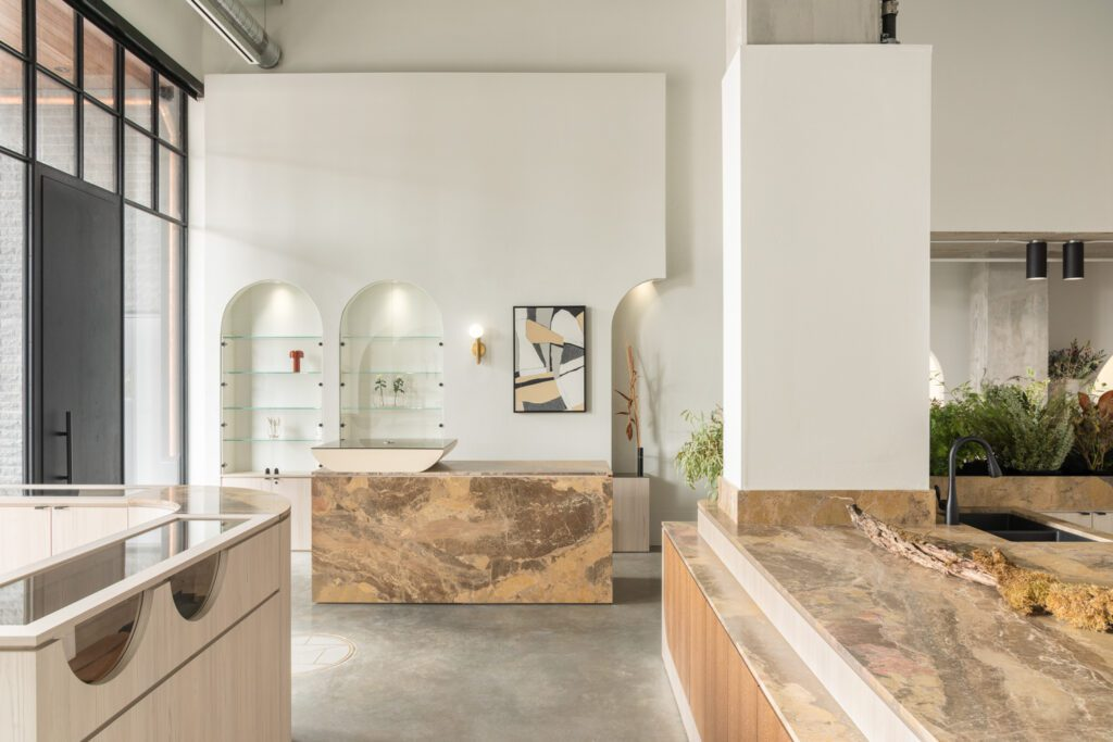 Brass and precise millwork with exposed grain balance an otherwise cool-toned palette.
