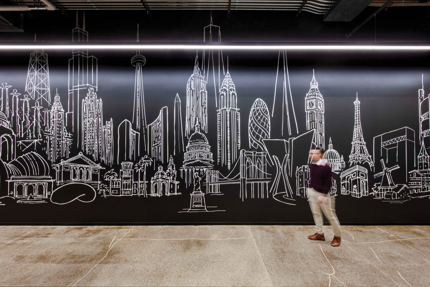 Cannon's design principal Mark Hirons's skyline sketch was printed on vinyl, cut out, and applied to a corridor's painted wall.