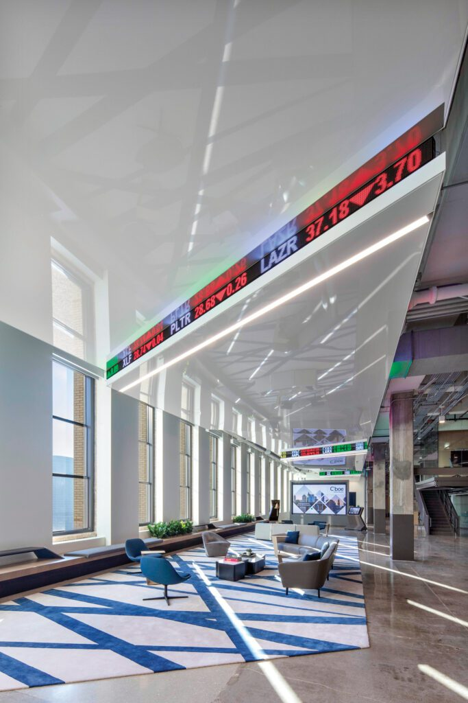 The stretched ceiling incorporates stock tickers rendered in LEDs.