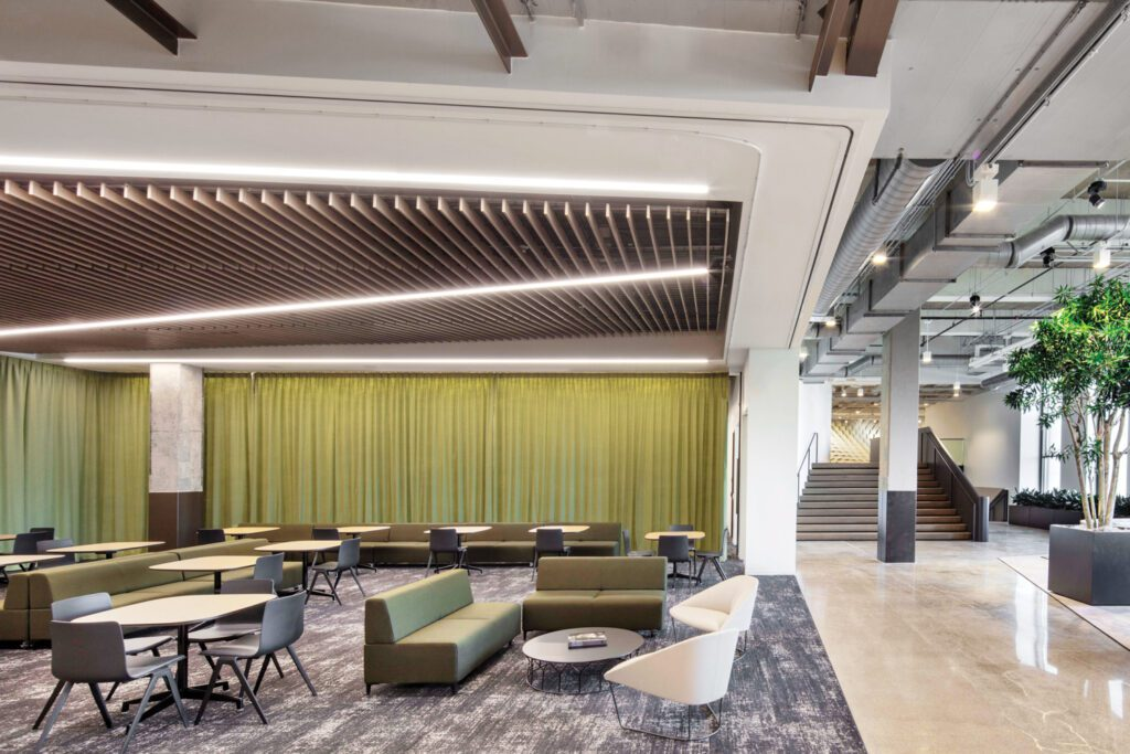 Operable partitions, sliding glass panels, and felt curtains allow the town hall lounge to be easily reconfigured.