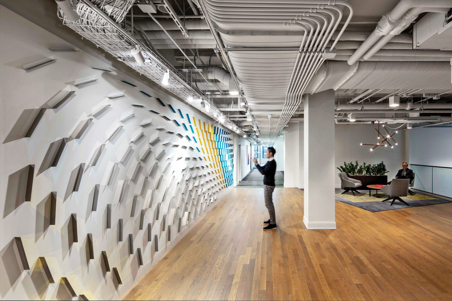 A hallway's stainless-steel wall installation by Luftwerk was inspired by wind patterns on nearby Lake Michigan.
