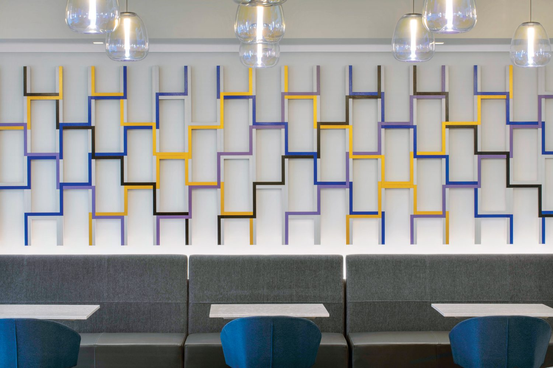 Behind a social hub's banquette, the geometries of Emi Ozawa's Woven evoke the movement of financial markets.