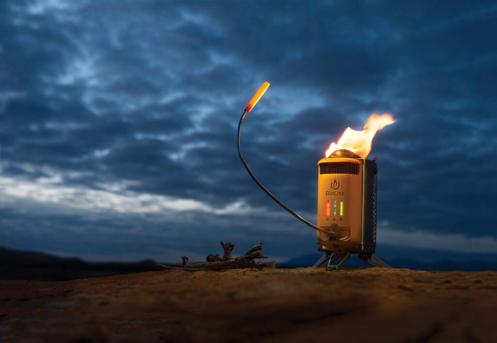 A portable, smokeless wood-burning stove that turns fire into electricity and cooks your meals at the same time.