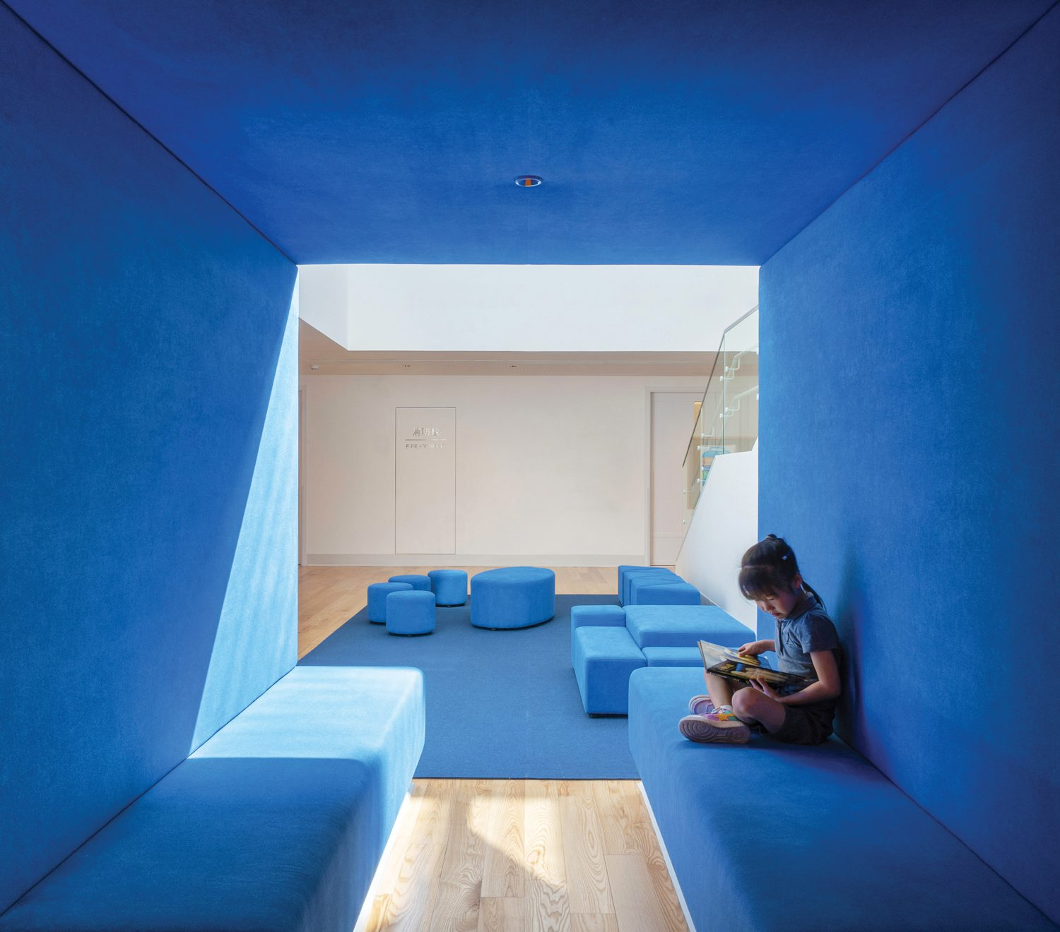 A blue alcove for reading or rest.