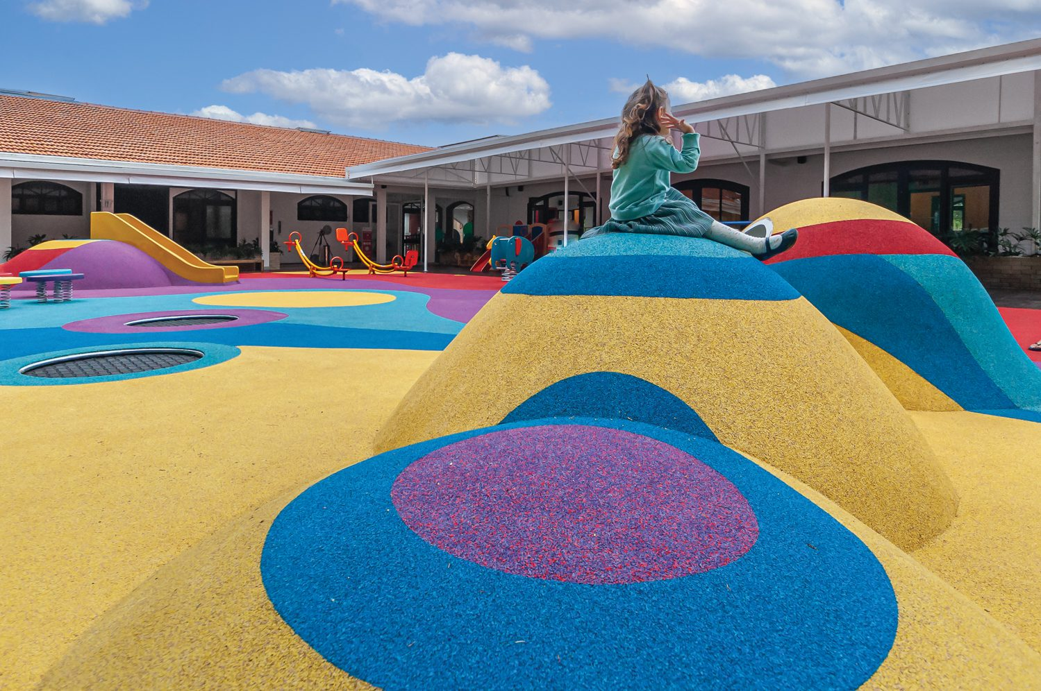 A mound of colorful hills in the outdoor play area.